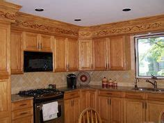 kitchen cabinets w crown moulding ron peters custom cabinet with transition trim extend kitchen cabinet to