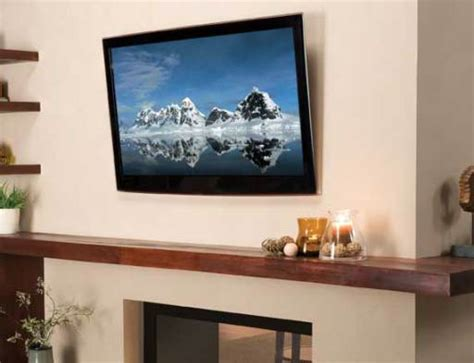 tips for hanging a flat screen tv over a fireplace what to look for in a tv wall mount electronic house