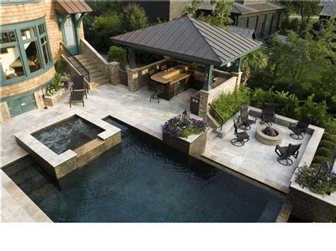 outdoor kitchen designs with pool pool with firepit waterfall and outdoor kitchen bing