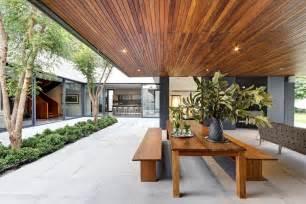 Dark wood ceiling panels interior design ideas