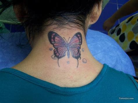 butterfly tattoo on neck small area woman gets butterfly tattoo on back of neck people