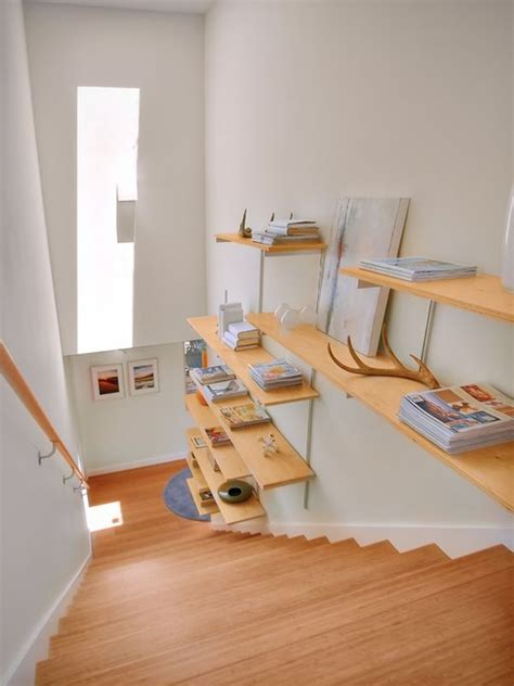 stairway wall mounted bookcase tips for utilizing a stairway wall