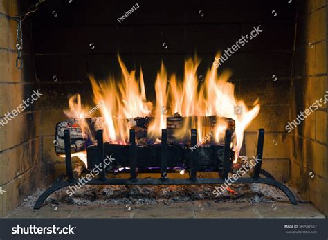 Starting In Fireplace by Fireplace Closeup Firewood Burning Stock Photo