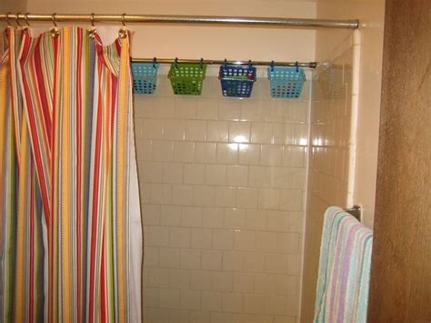 dollar tree shower curtain just created some extra bathroom storage in our tiny