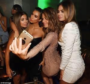 Snakeskin mini dress as she parties with kim kardashian in las vegas