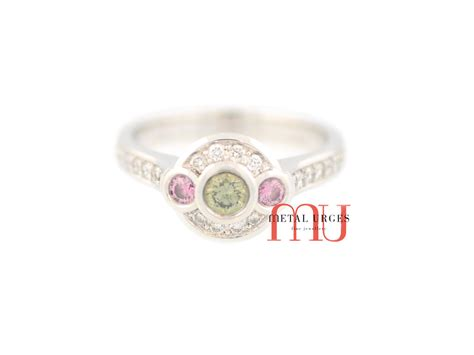 green and australian argyle pink engagement ring