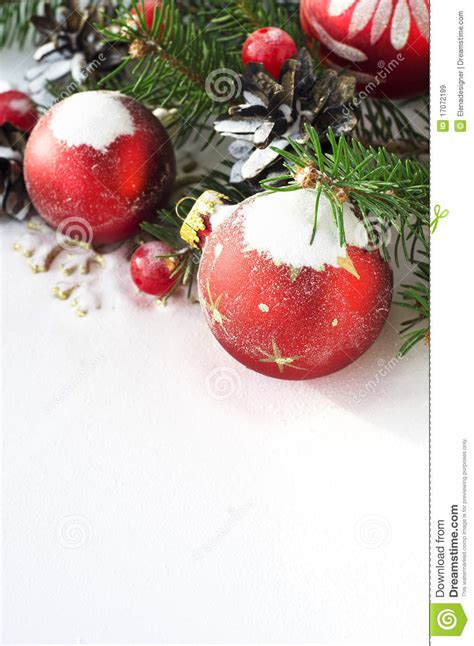 xmas tree and baubles on the snow royalty free stock