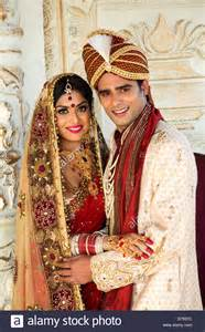 Groom Indian Wedding Dress Indian Bride And Groom In Traditional Wedding Dress Stock Photo Royalty Free Image 56050720