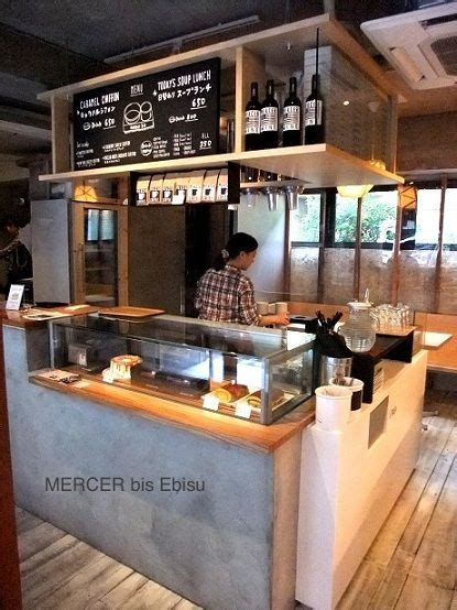 Good use of overhead space. Concrete counter, wooden