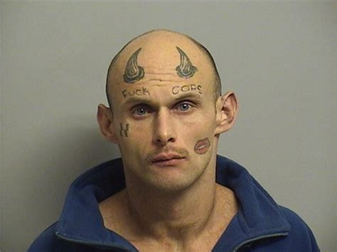 cops arrest oklahoma man who has quot cops quot tattooed on