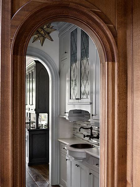 arched butler pantry doorway transitional kitchen
