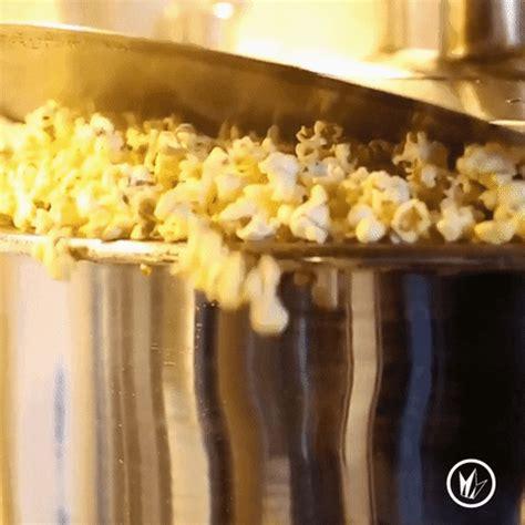 pop popcorn gif  regal cinemas find share  giphy