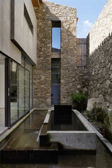 stone design spanish stable turned contemporary stone home modern