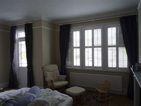 shutters with curtains interlined blackout curtains white wood pole white wooden