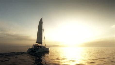 catamaran storm video sailboat in the crisp sea storm at sunset and big waves