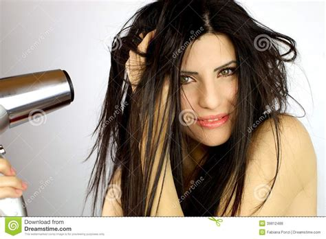 Great Dryer Happy Pretty Hair by Beautiful Model Drying Hair Stock Photo