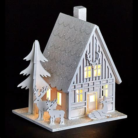 white wooden reindeer white led wooden house with reindeer buy at qd stores