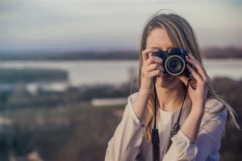 photographer woman girl  holding dslr camera