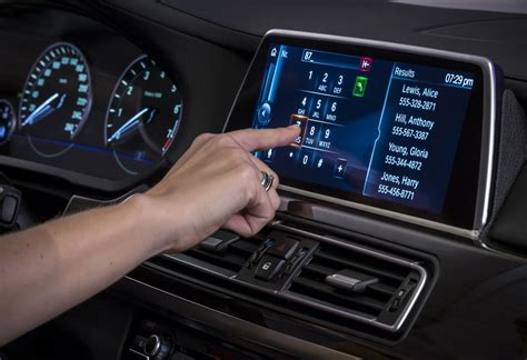 ces   gen bmw idrive finally adopts touchscreen