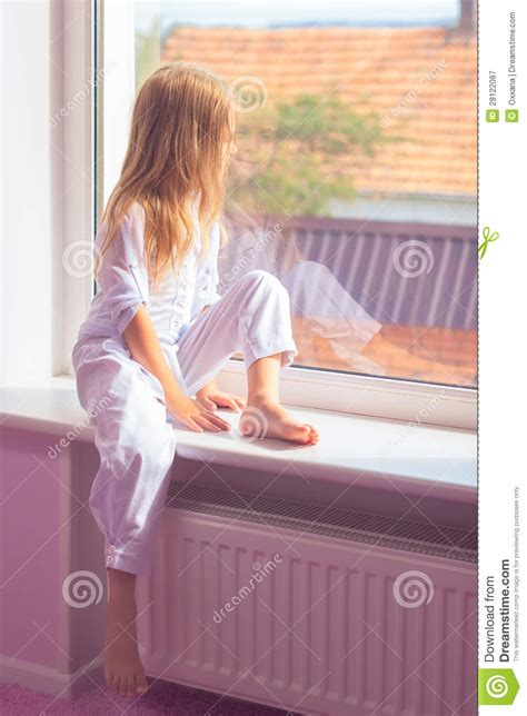 sitting window sitting near the window stock image image 28122087
