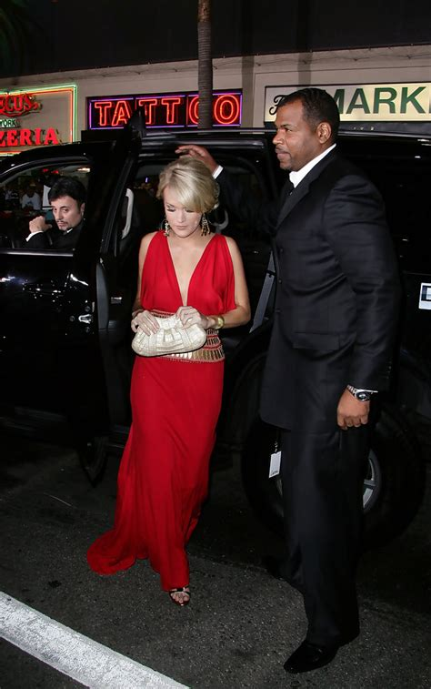 Carrie Underwood With Their Clutches by Carrie Underwood Metallic Clutch Carrie Underwood