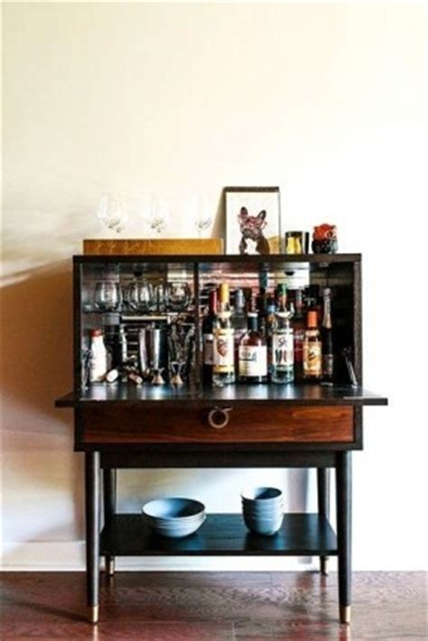hide a bar liquor cabinet thing