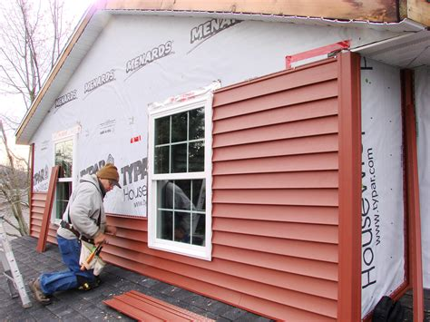 house siding installation should you paint or put siding on your rental property in