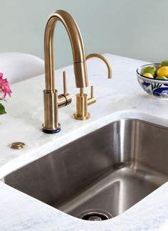 Kitchen Designs By Delta Brushed Gold Kohler Karbon Tap And Sink With Marble Work