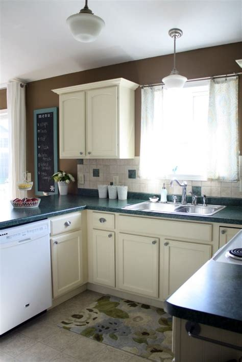 Kitchen Cabinets With White Trim by How To Paint Wood Cabinets Trim And Doors From To White