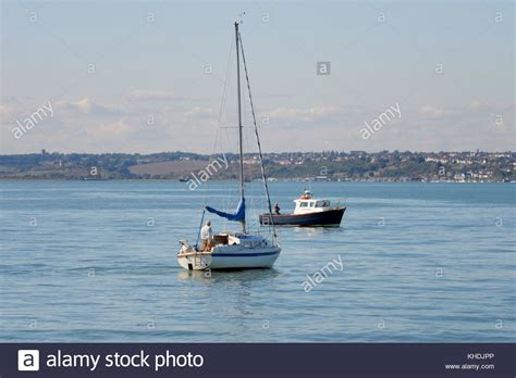 sailing boat under power sailing boat thames estuary stock photos sailing boat