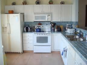 white kitchen cabinets and white appliances decor