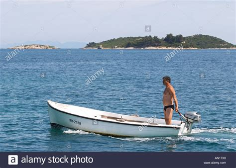 honda small boat motor a man standing in a small boat with a honda outboard motor