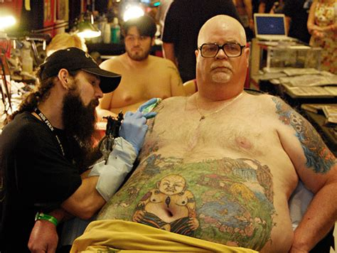 buddha belly man this is the awesomest tattoo ever