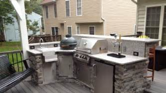 shaped stone facade outdoor kichen with sink beer dispenser and island build custom built grills smokers amp kitchens bbq