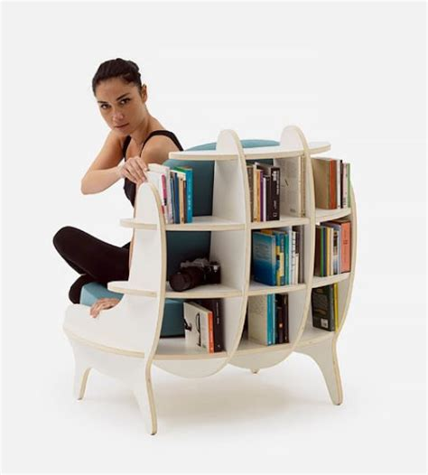 comfy chair with built in bookshelves for book