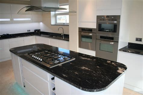 black granite bench tops cosmic black granite benchtops with white cupboard fronts kitchen pinterest black granite