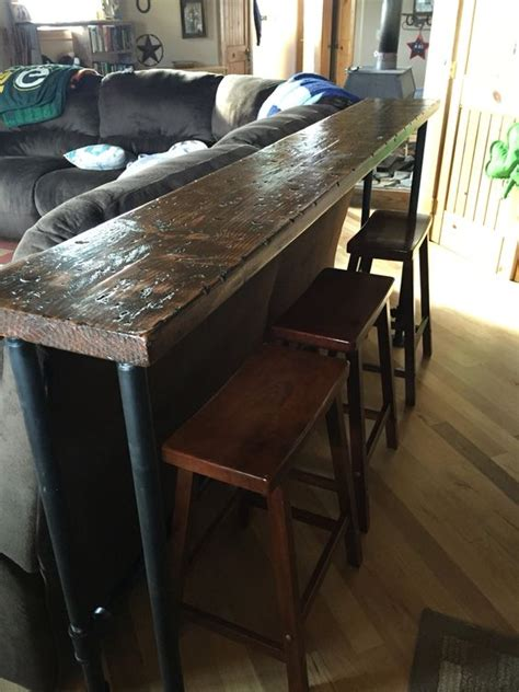 the bar top 1 inch pipe and 2x12 stained
