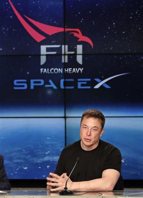 elon musk rocket tesla roadster cruises toward asteroid belt portland