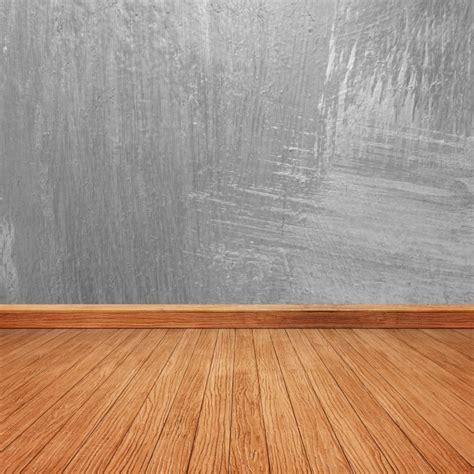 Un Pavimento Di Cemento O Legno pavimento in legno con un muro di cemento scaricare foto