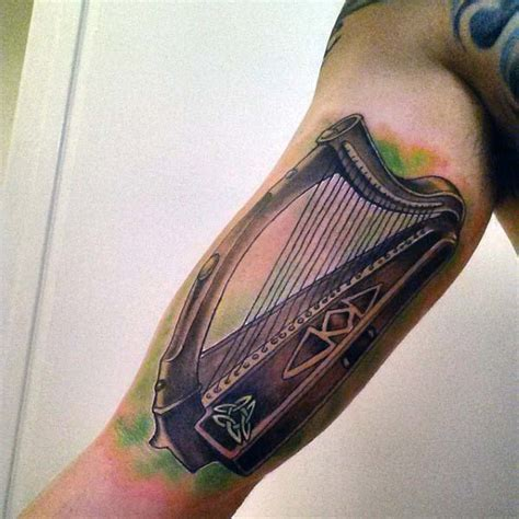irish harp tattoo 70 tattoos for ireland inspired design ideas