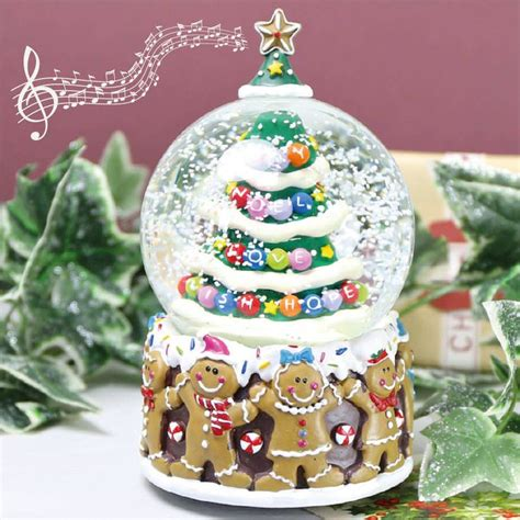 christmas tree and gingerbread man musical snowglobe by