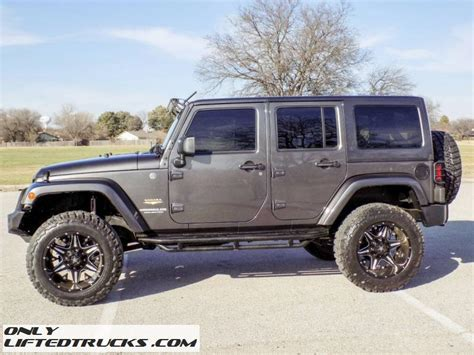 Lifted Grey 2014 Jeep Wrangler Unlimited Sahara Conversion