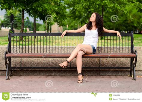 sitting bench girl sitting on a bench stock photo image of misses