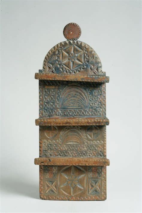 Carved and Painted Poplar Spoon Rack Sold For $ 5,500