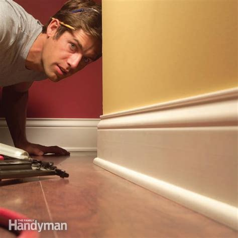 how to install wood floor without removing baseboards how to install baseboard molding even on crooked walls the family handyman