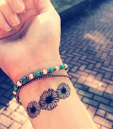 daisy wrist tattoos 25 best ideas about designs on