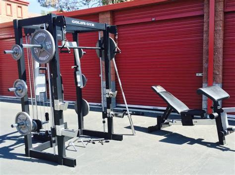 golds gym bench press bar golds gym bench press w 300lbs of weights