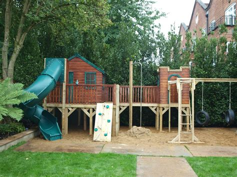 treehouse with swing treehouse on a platform with activities and spiral slide