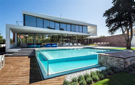 swimming pool house glass walled swimming pools 10 amazing designs