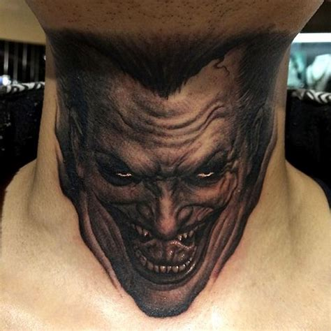 neck tattoo getting job sick realistic black and white joker face neck tattoo by